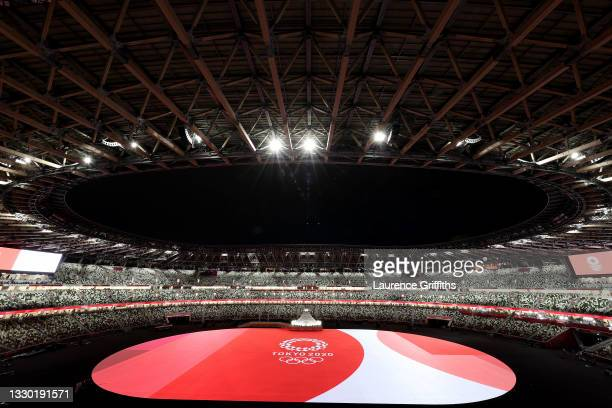 General view inside the stadium as the Tokyo 2020 Logo and Olympic Rings are seen prior to the Opening Ceremony of the Tokyo 2020 Olympic Games at...