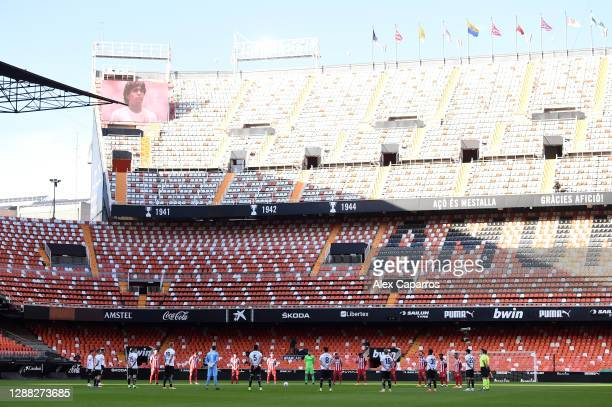 General view inside the stadium as Valencia CF and Atletico de Madrid players observe a minutes silence for former footballer, Diego Maradona, who...