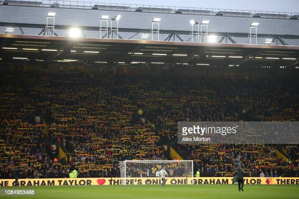 General view inside the stadium as Watford fans holds up scarfs in memory of Graham Taylor prior to the Premier League match between Watford FC and...