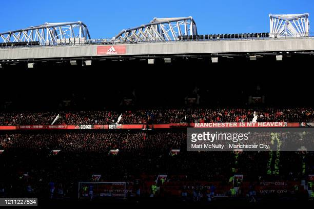 General view inside the stadium during a sunset during the Premier League match between Manchester United and Manchester City at Old Trafford on...