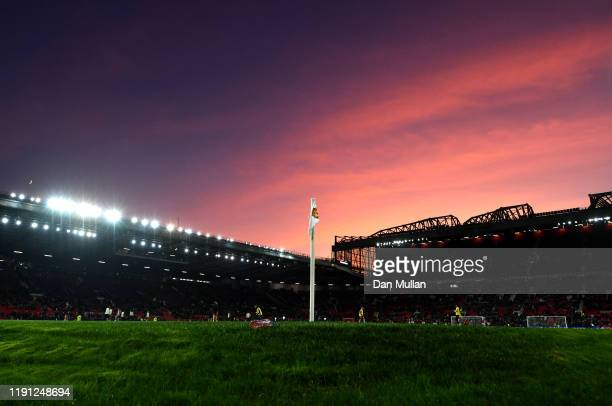 General view inside the stadium of a corner flag as the sun sets ahead of the Premier League match between Manchester United and Aston Villa at Old...