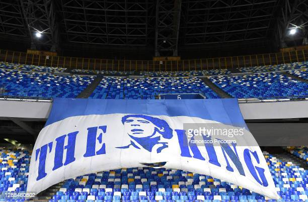 General view inside the stadium of a flag in memory of former footballer, Diego Maradona, who recently passed away prior to the Serie A match between...