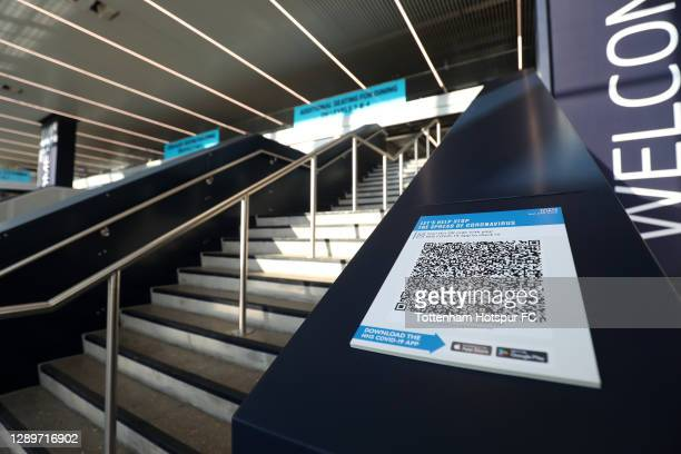 General view inside the stadium of a QR code linking to the NHS COVID-19 app in preparation of fans entering the stadium ahead of the Premier League...