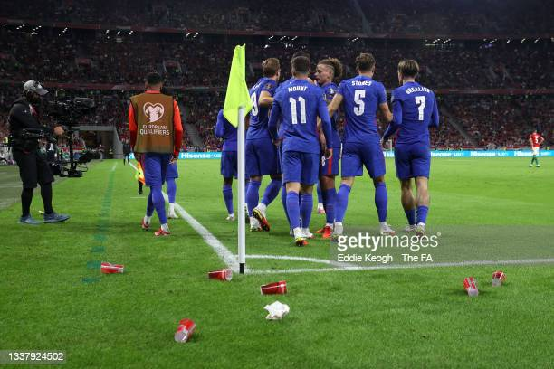 General view inside the stadium of cups thrown onto the pitch after Raheem Sterling of England s1g during the 2022 FIFA World Cup Qualifier match...