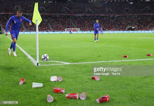 General view inside the stadium of cups thrown onto the pitch as Mason Mount of England takes a corner during the 2022 FIFA World Cup Qualifier match...