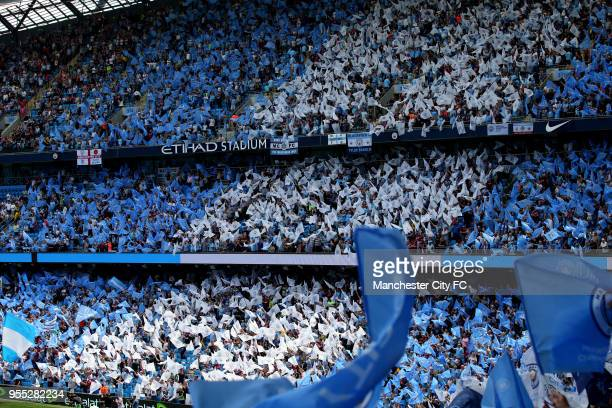 General view inside the stadium of Manchester City fans waving flags during the Premier League match between Manchester City and Huddersfield Town at...