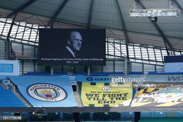 General view inside the stadium of the big screen during a two minute silence in memory of HRH Prince Phillip, The Duke of Edinburgh who passed away...