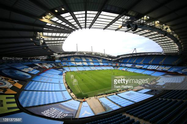 General view inside the stadium of the empty stands ahead of the Premier League match between Manchester City and Burnley FC at Etihad Stadium on...