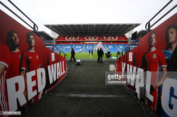 General view inside the stadium of the tunnel with a mural saying the red wall before the UEFA Nations League B group four match between Wales and...