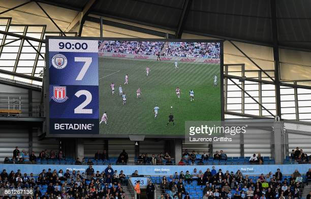 General view inside the stadium shows the scoreboard during the Premier League match between Manchester City and Stoke City at Etihad Stadium on...