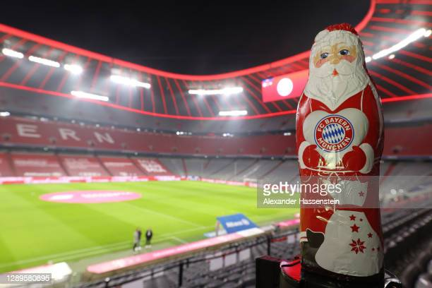 General view inside the stadium where an inflatable Father Christmas with the FC Bayern Munich crest on it is seen prior to the Bundesliga match...