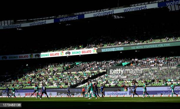 General view inside the stadium where fans are seen in the stands during the Bundesliga match between SV Werder Bremen and Hertha BSC at Wohninvest...