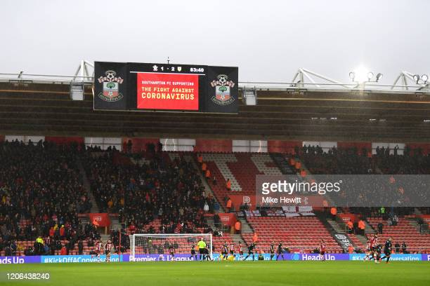 General view inside the stadium where the big screen displays a message of support against the Coronavirus during the Premier League match between...