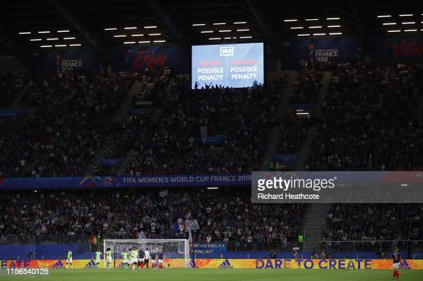 General view inside the stadium where the LED screen shows a VAR review is in place regarding a potential penalty during the 2019 FIFA Women's World...