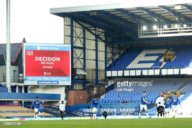 General view inside the stadium where the scoreboard shows that a VAR review is in place, before an Everton goal is then disallowed for offside...