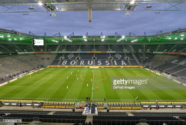 General view inside the stadium with Empty seats are seen during the Bundesliga match between Borussia Moenchengladbach and 1. FC Koeln at...