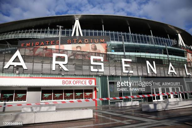 General view is pictured of the Emirates Stadium in London on March 13, 2020. - The English Premier League suspended all fixtures until April 4 on...