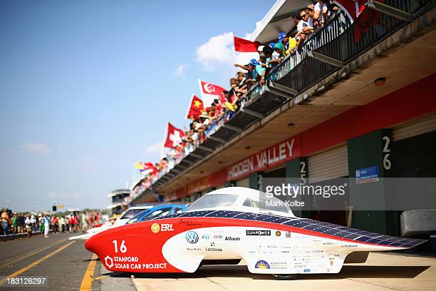 General view is seen as all 40 solar cars and team members involved in the Bridgestone World Solar Challenge pose for a photograph at the Hidden...