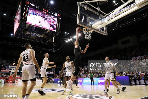 General view is seen as Andrew Ogilvy of the Hawks lays up a shot during the round 11 NBL match between the Illawarra Hawks and Melbourne United at...