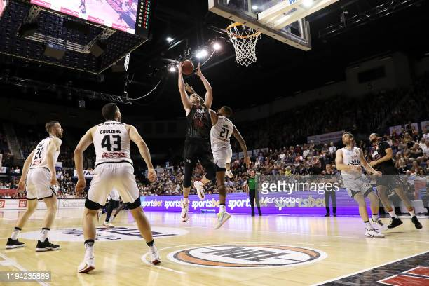 General view is seen as Andrew Ogilvy of the Hawks wins the rebound during the round 11 NBL match between the Illawarra Hawks and Melbourne United at...