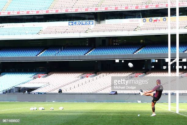 A general view is seen as Anthony Milford of the Maroonskicks the ball during a Queensland Maroons Captain's Run at the Melbourne Cricket Ground on...
