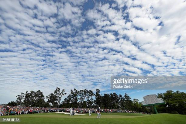 A general view is seen as Cameron Smith of Australia putts on the 18th green during the final round of the 2018 Masters Tournament at Augusta...