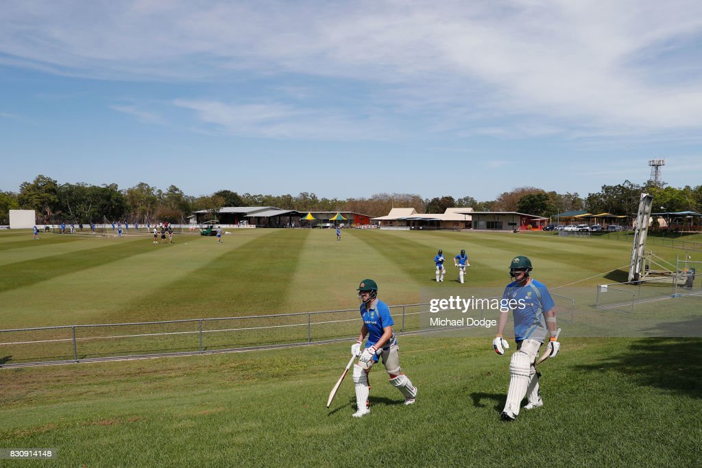 A general view is seen as Chris Tremain (R) walks to the nets during an Australia Test cricket squad training session at Marrara Cricket Ground on August 13, 2017 in Darwin, Australia.