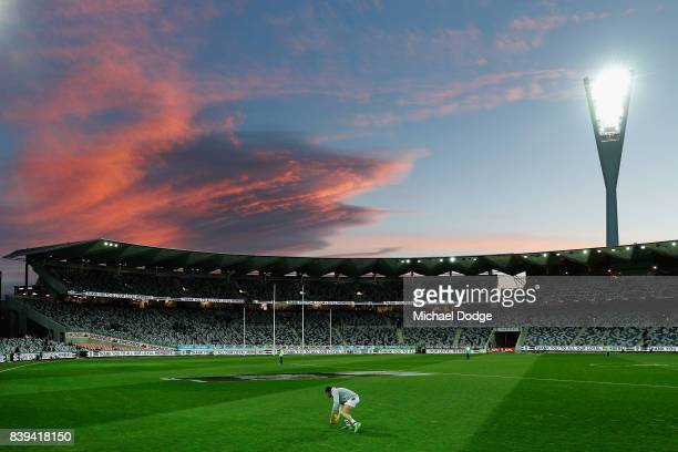 A general view is seen as Daniel Menzel of the Cats warms up during the round 23 AFL match between the Geelong Cats and the Greater Western Sydney...