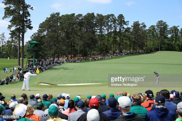 A general view is seen as Dustin Johnson of the United States putts on the second green during the final round of the 2018 Masters Tournament at...