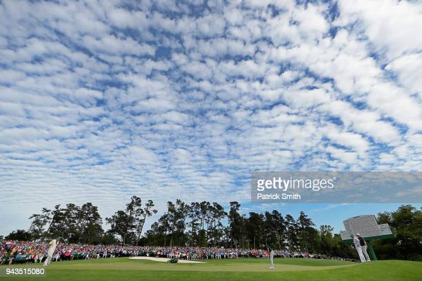 A general view is seen as Dustin Johnson of the United States putts on the 18th green during the final round of the 2018 Masters Tournament at...