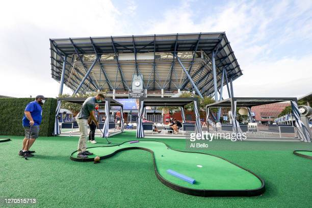 General view is seen as guests play golf outside of Arthur Ashe Stadium on Day Four of the 2020 US Open at the USTA Billie Jean King National Tennis...