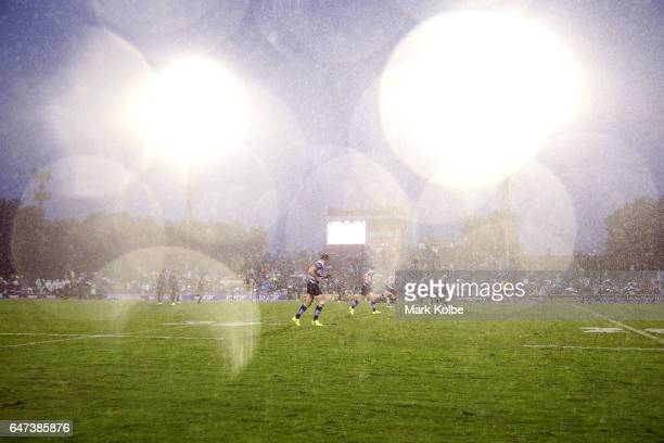 A general view is seen as heavy rain falls during the round one NRL match between the Canterbury Bulldogs and the Melbourne Storm at Belmore Sports...