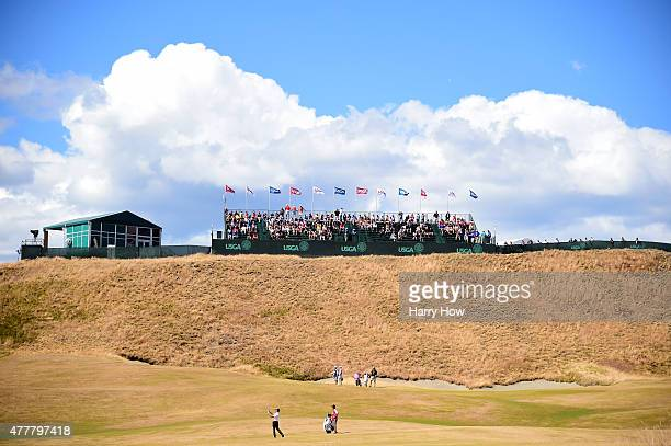 A general view is seen as Kevin Lucas of the United States hits a shot on the first hole fairway as a gallery of fans look on during the second round...
