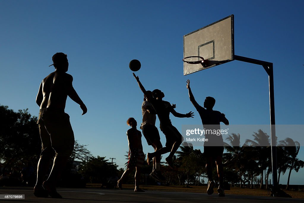 A general view is seen as local men play basketball at a sea side court in Apia on a training day for the Samoa 2015 Commonwealth Youth Games on September 6, 2015 in Apia, Samoa.