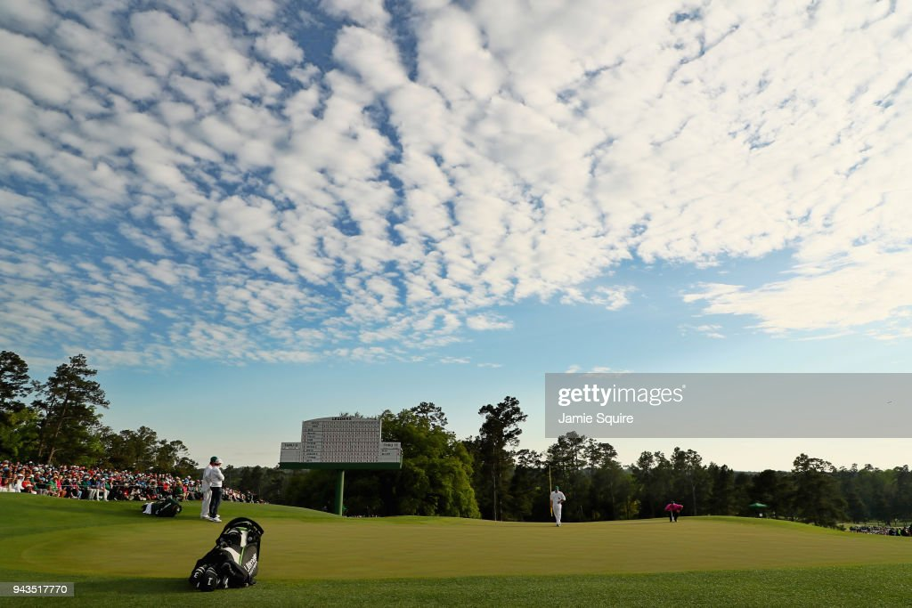 A general view is seen as Patrick Reed of the United States lines up a putt on the 18th green as Rory McIlroy of Northern Ireland looks on during the final round of the 2018 Masters Tournament at Augusta National Golf Club on April 8, 2018 in Augusta, Georgia.