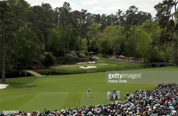 A general view is seen as patrons watch Branden Grace of South Africa plays his tee shot on the 12th hole during the final round of the 2018 Masters...