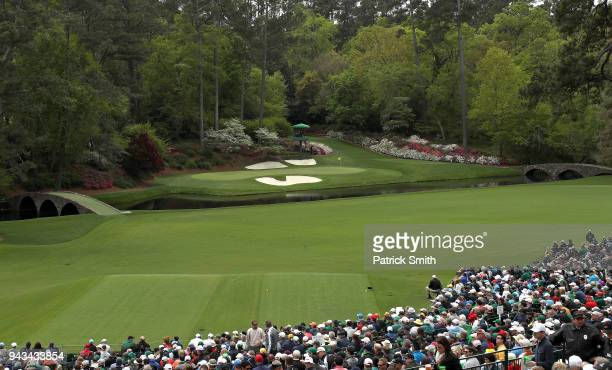 General view is seen as patrons watch play on the 12th hole during the final round of the 2018 Masters Tournament at Augusta National Golf Club on...