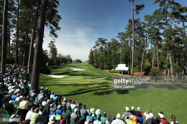 A general view is seen as patrons watch play on the tenth green during the first round of the 2018 Masters Tournament at Augusta National Golf Club...