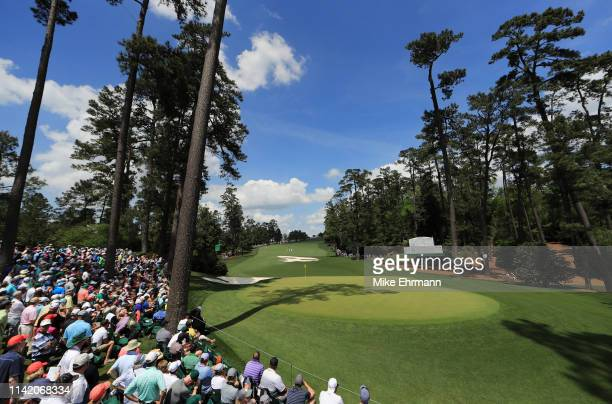 A general view is seen as patrons watch the 10th green during the first round of the Masters at Augusta National Golf Club on April 11 2019 in...