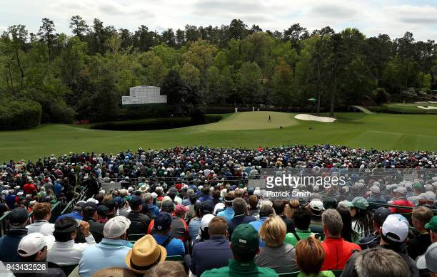 A general view is seen as patrons watch Tiger Woods of the United States on the 12th green during the final round of the 2018 Masters Tournament at...