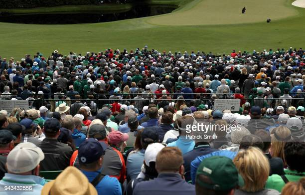 A general view is seen as patrons watch Tiger Woods of the United States on the 11th green during the final round of the 2018 Masters Tournament at...