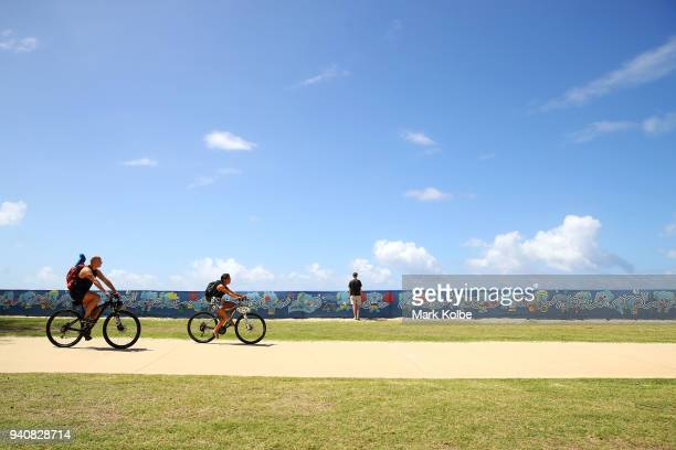 A general view is seen as people pass games signage on a beachside walkway ahead of the 2018 Commonwealth Games on April 2 2018 in Gold Coast...