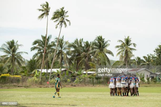A general view is seen as the Coastal Owls team prayer before kickoff during the Fiji National Rugby League western conference Nadroga zone Premier...