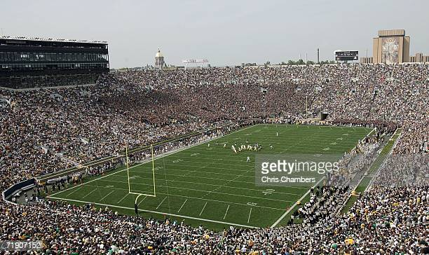 General view is seen as the Michigan Wolverines run an offensive play against the defense of the Notre Dame Fighting Irish September 16, 2006 at...