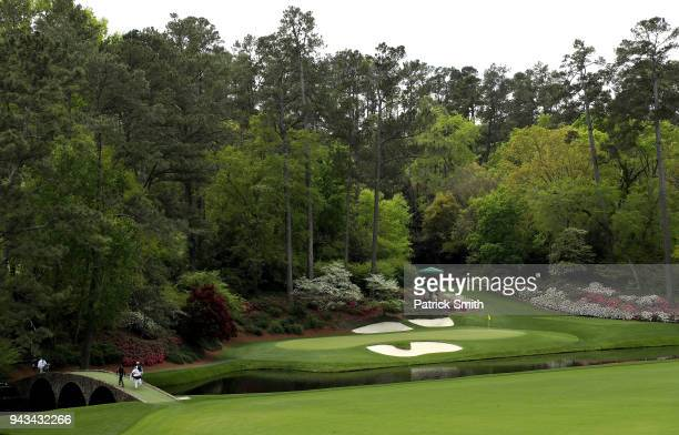 General view is seen as Tiger Woods of the United States and Rafael Cabrera-Bello of Spain walk over the Hogan Bridge to the 12th green during the...