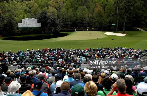 A general view is seen as Tiger Woods of the United States putts on the 11th green during the final round of the 2018 Masters Tournament at Augusta...