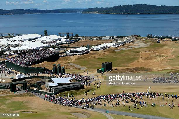 A general view is seen as Tiger Woods of the United States Rickie Fowler of the United States and Louis Oosthuizen of South Africa walk off the first...