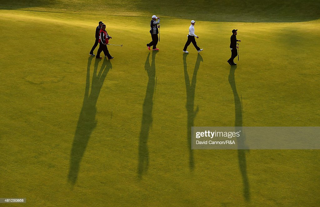 A general view is seen as Tyrrell Hatton of England, Amateur Paul Kinnear of England and Scott Arnold of Australia walk up off the 18th hole with their caddies during the second round of the 144th Open Championship at The Old Course on July 18, 2015 in St Andrews, Scotland.