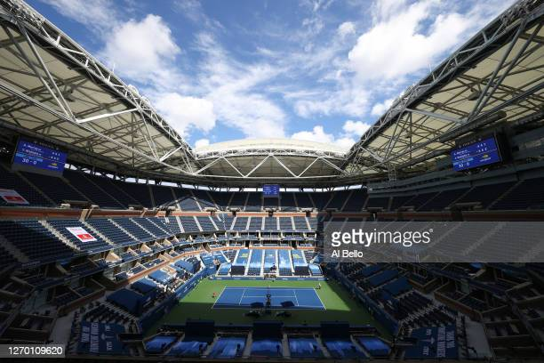 General view is seen as Yoshihito Nishioka of Japan returns the ball during his Men's Singles first round match against Andy Murray of Great Britain...