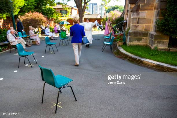 A general view is seen of a service held in the yard of St Paul's Anglican Church in Burwood with seating observant of social distancing on March 22...